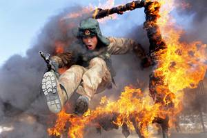 china's big increase in military spending is a great reason to check out this photo of a soldier jumping through fire